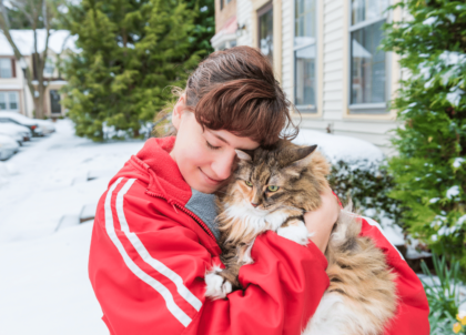 pet owner holding her cat